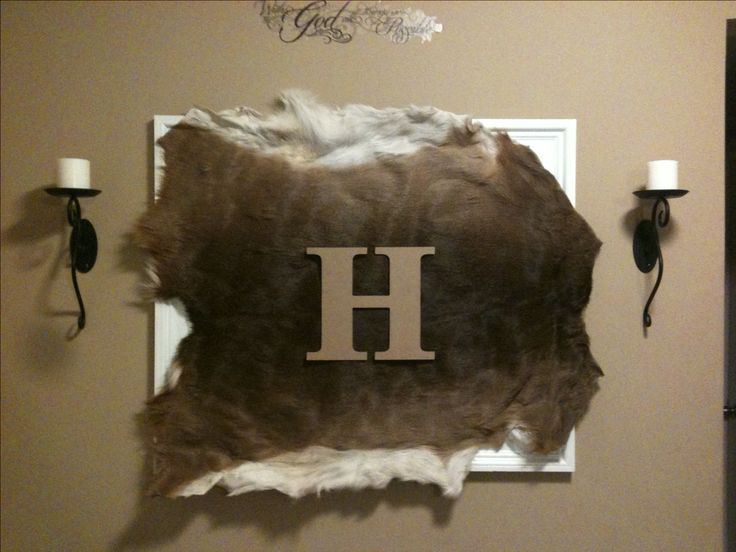 Deer skin mounted on frame with monogram... A unique way to integrate your hubby's hunting trophy with the decor