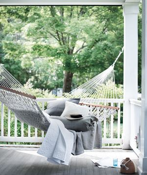 Easy, Beach-Inspired Decorating Ideas    Create a Napping Nook  A hammock propped for comfort makes a tempting resting and reading spot through fall.