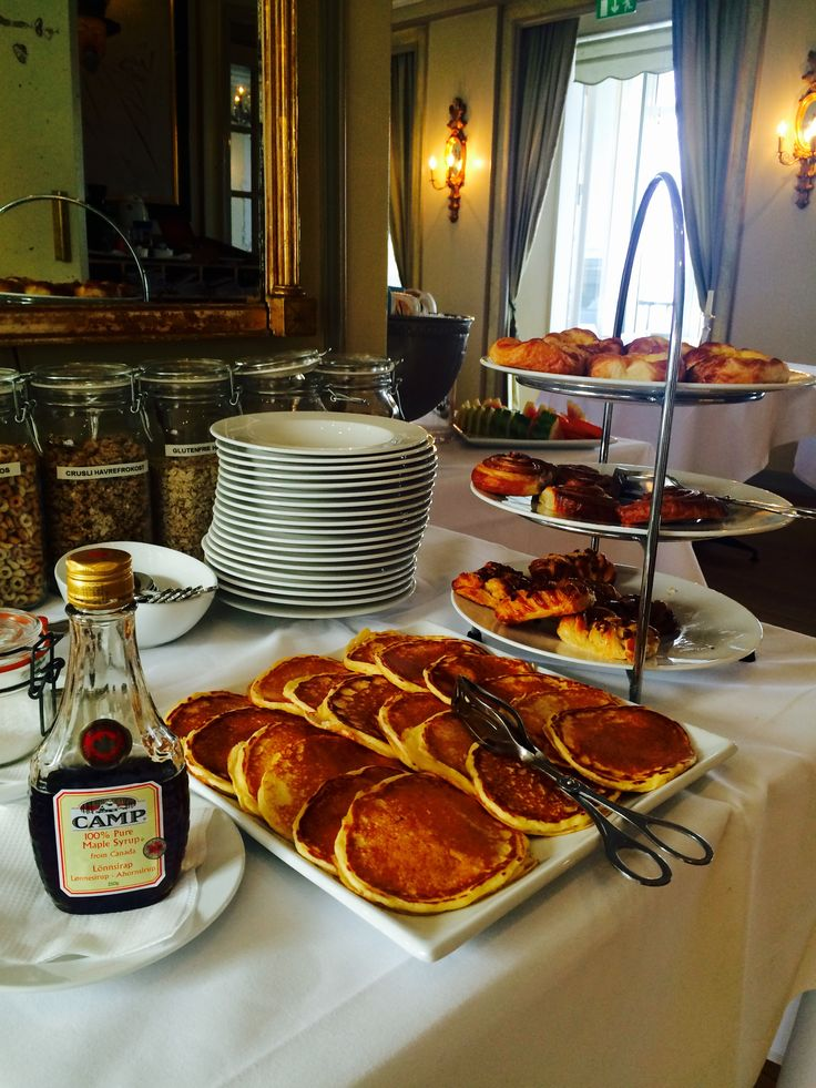 "Norwegian ""muffeluffer"". A delicious cross between waffles and pancakes.  And other delightful pastries. Breakfast buffet served in our restaurant. Hotel breakfast, hotel living, good morning. Hotel Refsnes Gods."