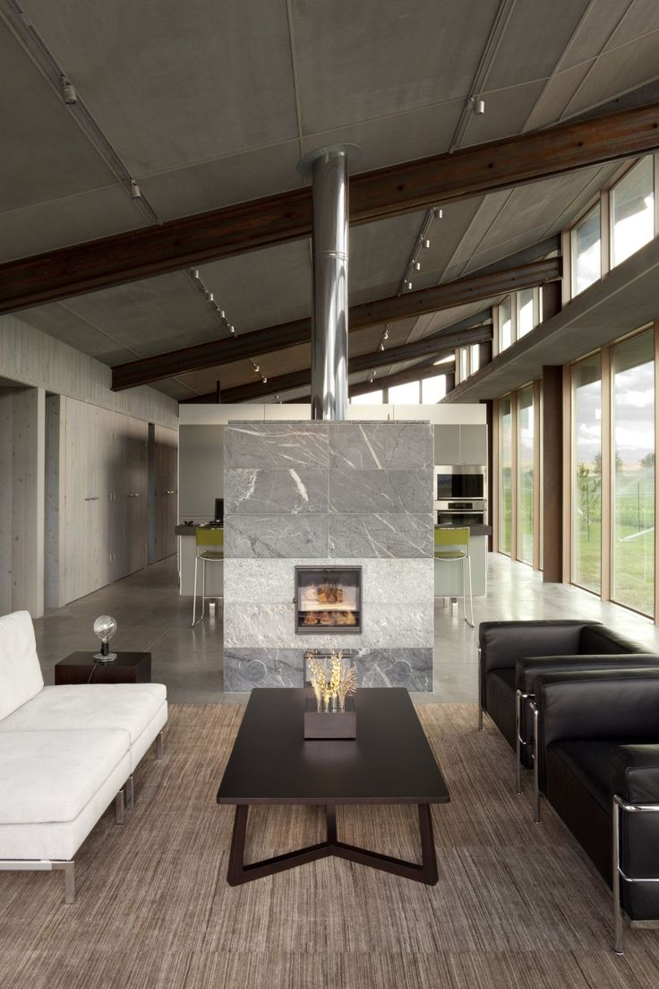double sided fireplace a great divider between living and dining