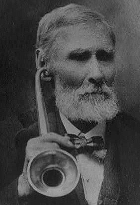 Goat Horn Ear Trumpet: W. P. Zubar with eartrumpet (c. 1900) - Credit: Library of Congress / Ear trumpets were early hearing aids. They were typically made from sheet iron, silver, wood, animal horns, & even snail shell. In 1963, the ear trumpet producer F. C. Rein & Son in London ended activity as the last company of its kind.