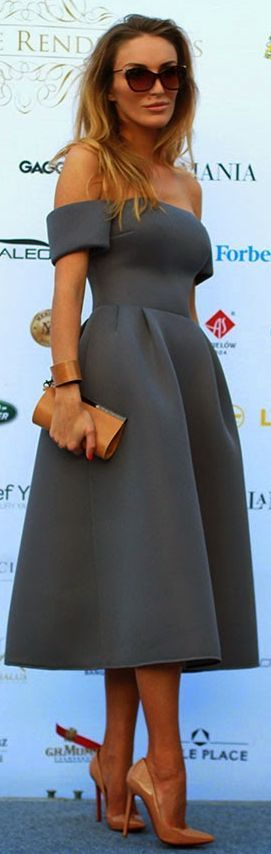 Sylvia Maidan Grey Luxe Off Shoulder Midi Dress The off shoulder sleeves appear to be padded or at least interlinked. The whole dress appears to be interlinked. So smooth and sculptural. Not a wrinkle, just the oh so neat pleats at each outer waist mark.
