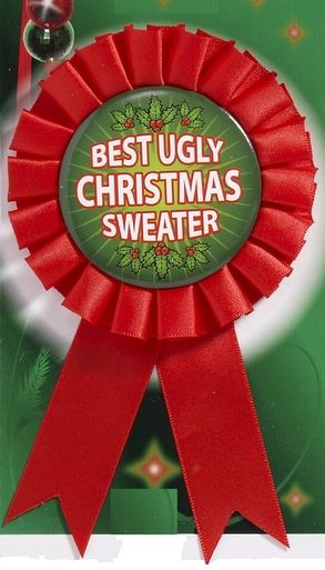 """Buy an affordable prize for the winner of your ugly Christmas sweater party. This award ribbon features a button which reads """"Best Ugly Christmas Sweater"""". Ribbon measures approx 4"""" long. All of our ugly Christmas sweaters and party accessories ship from Ontario, Canada"""