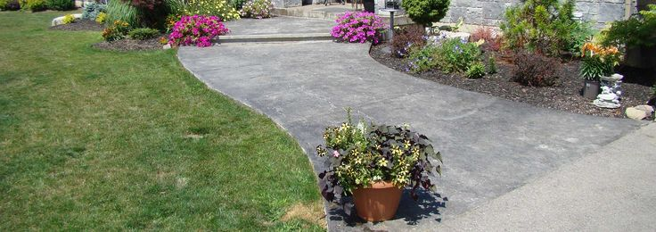 Stamped coloured decorative grey concrete sidewalk.