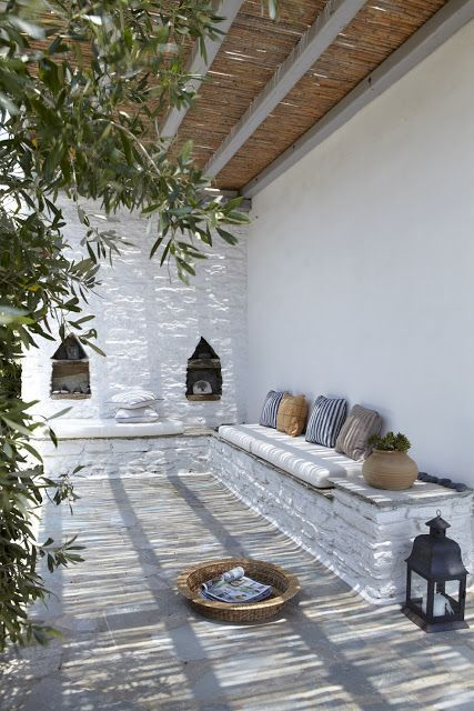 Beautiful. Peaceful. Colour scheme and pergola. Built-in seating and Moroccan details.