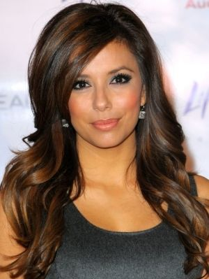 dark hair with caramel highlights.