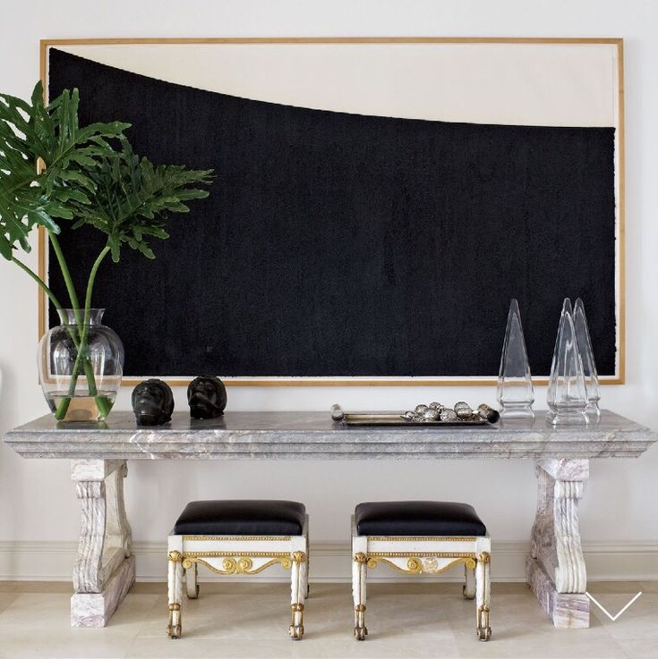 Showcasing a large scale piece of art, this perfect mix of accessories balance the vignette.