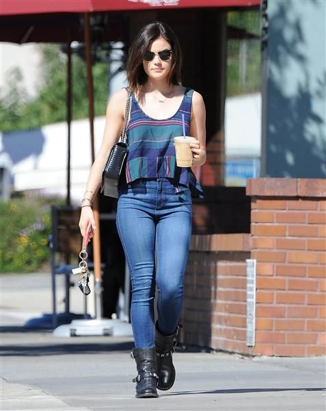 Cute and casual! Lucy Hale stepped out for coffee in Los Angeles on Feb. 12, 2015, in a striped crop top, jeans and black boots.