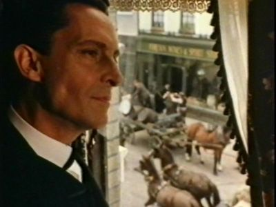Jeremy Brett as Sherlock Holmes - this scene of him by the window at Baker Street was at the opening of each show.