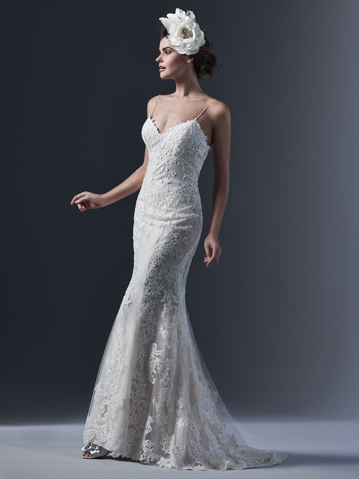 Sottero and Midgley - MATTEA, Refined elegance is found in this chic lace sheath wedding dress; accented with sexy spaghetti straps; demure illusion back and V-neckline. Finished with pearl buttons and zipper closure.
