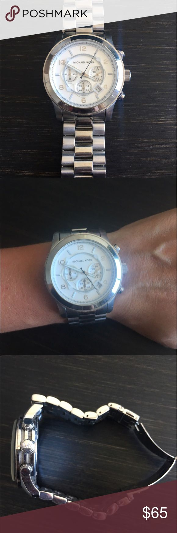 Michael Kors runway watch in silver Silver unisex watch, minor scratches on the band but the crystal is scratch-free! Michael Kors Accessories Watches