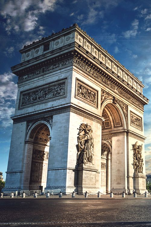 The Arc de Triomphe de l'Étoile is one of the most famous monuments in Paris. It stands in the centre of the Place Charles de Gaulle at the western end of the Champs-Élysées. The Arc de Triomphe (Triumphal Arch) honours those who fought and died for France in the French Revolutionary and Napoleonic Wars, with the names of all French victories and generals inscribed on its inner and outer surfaces. Beneath its vault lies the Tomb of the Unknown Soldier from World War I.