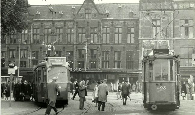 1962. View of the Stationsplein in Amsterdam. In the background the Centraal Station. In the center tram line 2. #amsterdam #1962 #Stationsplein