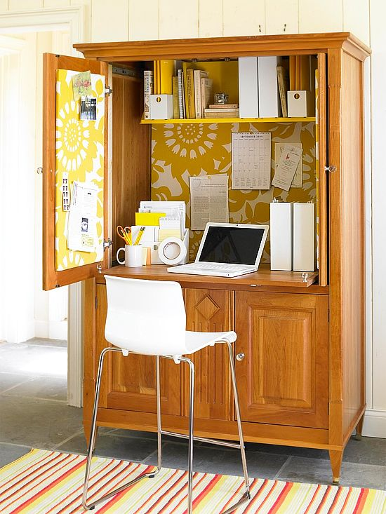 Contain a whole home office inside an armoire with a few clutter-concealing solutions. An upper shelf corrals reference books and magazine holders. Essential supplies such as pencils, scissors, and notepads have a place on the desktop, too, all kept in order with desk organizers.