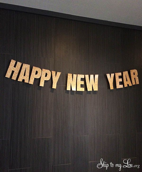 Glittery printable Happy New Year Banner, just print cut and hang for a festive party decoration! The best part these letters are glittery with no mess.