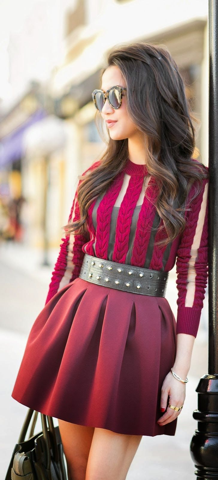 Dress in deep burgundy with very different details. Bodice has velvety vertical stripes alternating with sheer insets and the skirt is of an almost sailcloth stiffness that nonetheless looks soft. Fabulous belt!