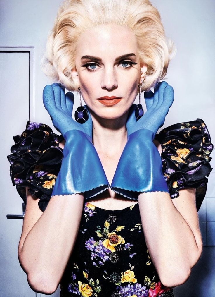 Iris Strubegger wears 50's inspired hairstyle with short curls. Black floral print dress by Dolce & Gabbana