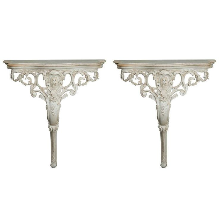 Pair French Wall-Mounted Highly Carved Consoles with Marble Tops   From a unique collection of antique and modern console tables at https://www.1stdibs.com/furniture/tables/console-tables/