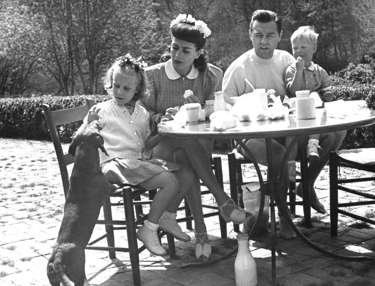 Joan Crawford and her then-husband, Philip Terry, have a picnic with their children and dog, 1945.