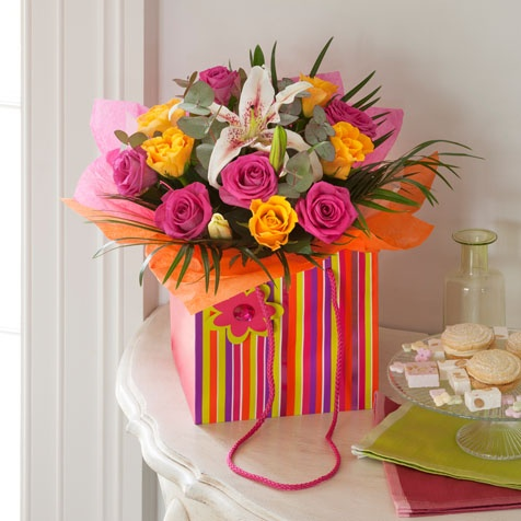 Glorious - A gorgeous mix of Pink and Orange Roses with a stunning lily and exotic foliage. #nextflowers