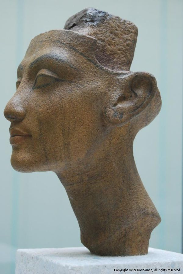 Granite head statue of Nefertiti. The securing post at head apex, allows for different hairstyles to adorn the head, Altes Museum, Berlin. Nefertiti, chief consort of the Egyptian Pharaoh Akhenaten had many titles including Hereditary Princess (iryt-p`t); Lady of Grace (nbt-im3t), Sweet of Love (bnrt-mrwt); Lady of The Two Lands (nbt-t3wy); Great King's Wife, his beloved (hmt-niswt-wrt meryt.f), Lady of all Women (hnwt-hmwt-nbwt); and Mistress of Upper and Lower Egypt (hnwt-Shm'w-mhw).