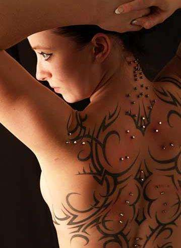It does look like tattoos and piercings! Pseudo Tattootography - The Dave Piper Tribal Collection is for the Fans of Non Committal Art (GALLERY)