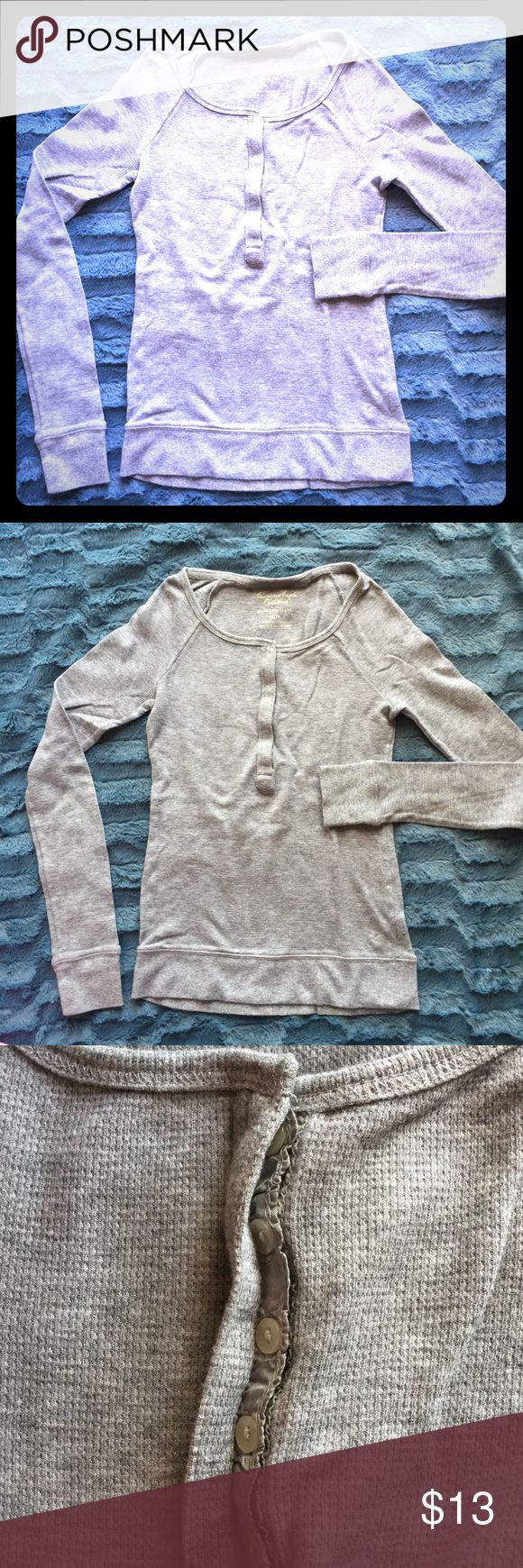 Grey long sleeve top, size XS Grey long sleeve top, hidden buttons in the front, metallic thread on the cuffs and waste line, gently used. Size XS American Eagle Outfitters Tops Tees - Long Sleeve