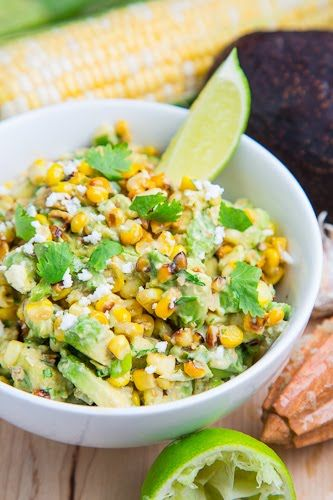 Esquites (Mexican Corn Salad) with Avocado - 1 tbsp Butter, 3 cups Corn/4 Ears (Cut from the Cob), 1/2 Jalapeno (Seeded and Finely Diced), 3 tbsp Mayonnaise, 1 clove Garlic (Grated), 2 Green Onions (Sliced), 1 handful Cilantro (Chopped), 1 Lime (Juice), 2 tbsp Cotija or Feta (Crumbled) and Chili Powder (to Taste)