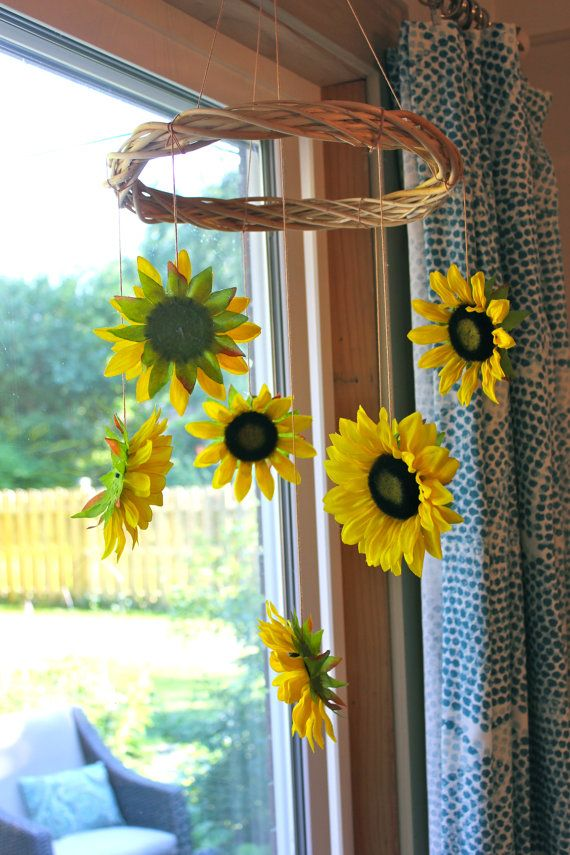 Sunflower Mobile by FrolickingLarkDesign on Etsy, $40.00...Could do this with my old wreaths and stars, spiders and sheep cut outs!