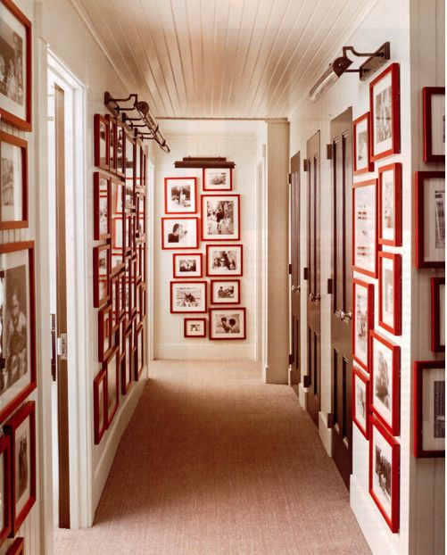 Boring hallway? Try this simple #DIY project: take a bunch of similar frames and paint them all one bold color. Add your favorite photos.Wall Art, Elle Decor, Hallways, Black And White, Gallery Walls, Red Frames, Frames Wall, Pictures Frames, White Wall