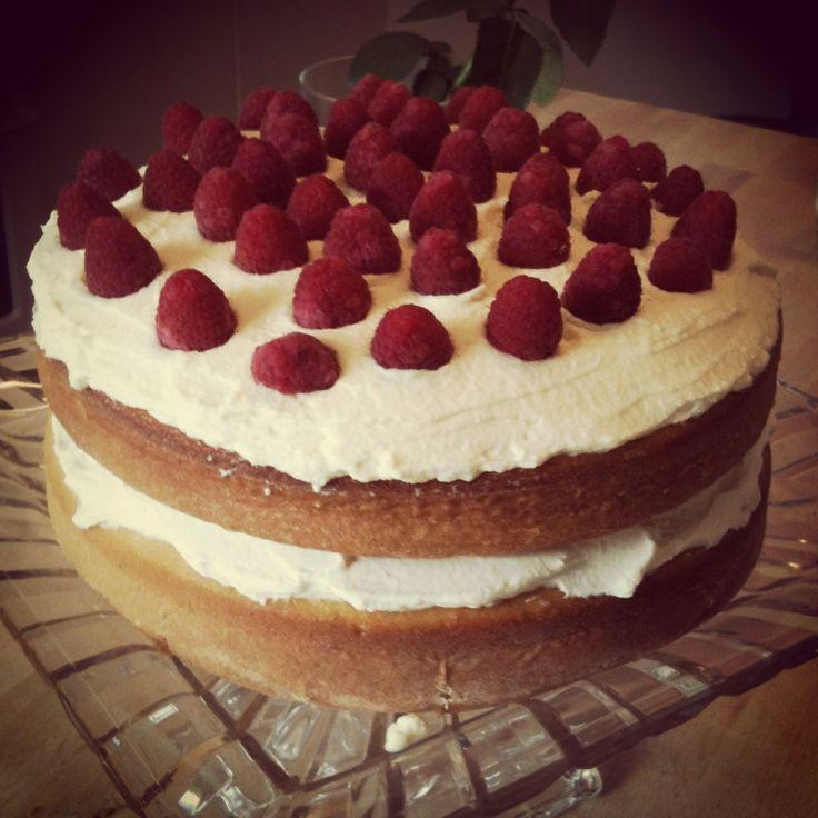 Layered banana cake with chantilly cream and fresh raspberries