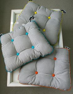 great chair cushion tutorial. You should see the other side of these! Cute!