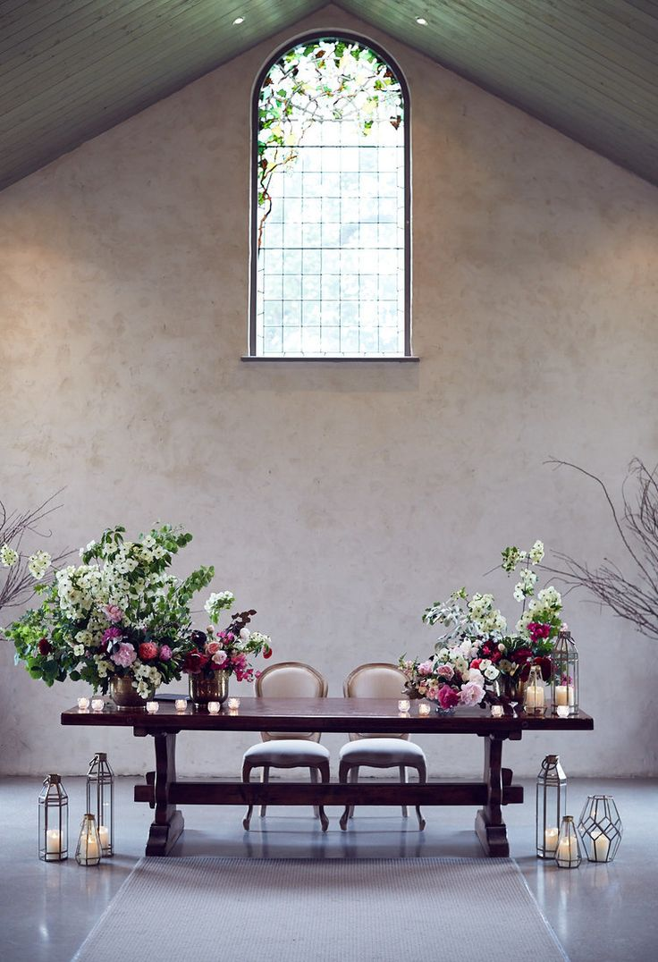 The Chapel #ceremony #chapel #wedding #stainedglass #flowers #arrangements #signingtable #candles