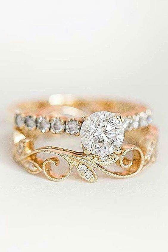 Would be really pretty with a different shaped center diamond, thinner band on the engagement ring and a third super thin encrusted band