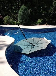 Check out my top tips for keeping your patio umbrella from blowing over and landing in the pool.  I've learned several lessons so that this doesn't happen any more.