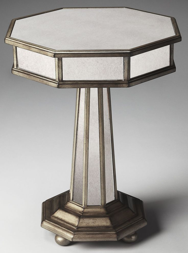 This Grecian-inspired mirrored accent table will reflect the beauty of your home while adding a natural glow. Expertly crafted from poplar hardwood solids and wood products, its antique mirrored glass panels and fly-specked pewter finish make this silhouette a stunning addition to any transitional living space.