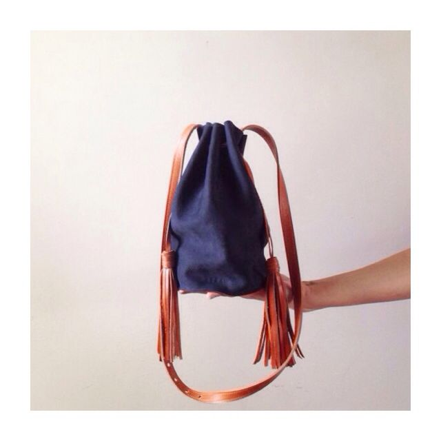 Limited edition bucket bag in surplus navy nubuck leather