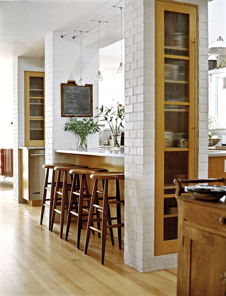 want to knock out a wall in kitchen to open up to great room, like these brick columns, they'd do the trick! and storage inside, brilliant!