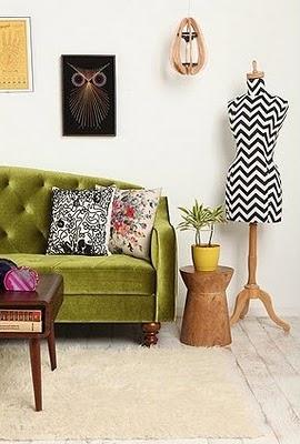 green velvet sofa + chevron dress form