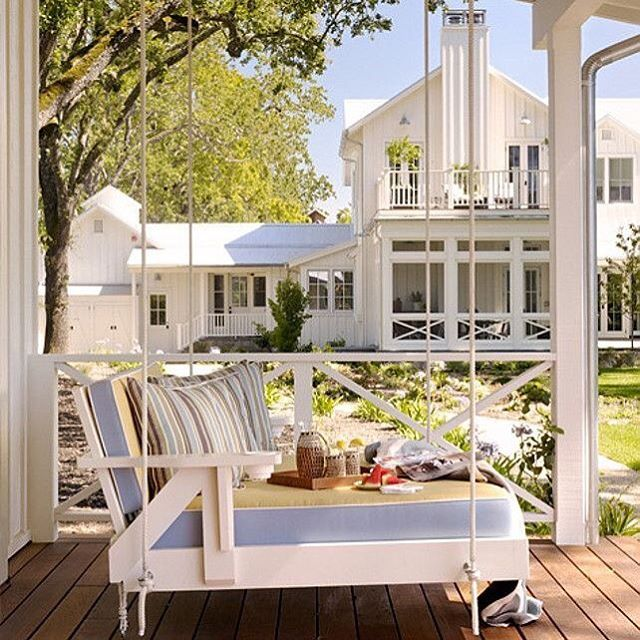 #BPHloves this transitional farmhouse featured on @homebunch complete with poolhouse and porch swing  #whitehouse #screenedporch #hamptonsstyle
