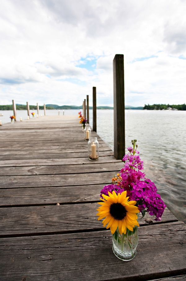 brandy. kinda like our idea.Lakeside Rustic Wedding - Rustic Wedding Chic.  Is there a dock you can have the ceremony on ?