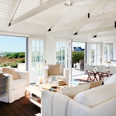To make this small home feel larger and the ceilings seem higher, designer Stephen Theroux brightened the walls, ceiling beams, and trusses with linen-white paint.