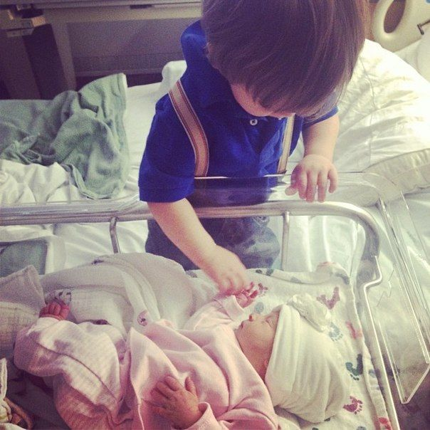 Big brother meeting his new sister.