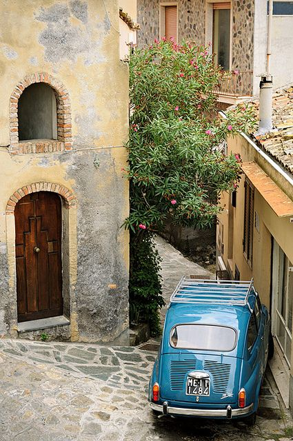 Fiat 600 in a narrow street in Castelmola - Sicily...amazing how they can get their cars into a tiny area