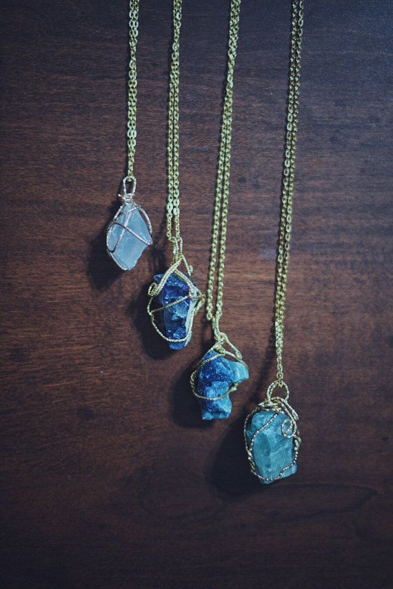 Crystal chunks (about 1 x 1) wire wrapped with golden wire on the end of a golden chain. There are a few different Crystal options- light emerald http://fancytemplestore.com