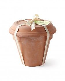 Great gift packing idea using terra cotta pots. Put a seed packet and bag of soil inside.