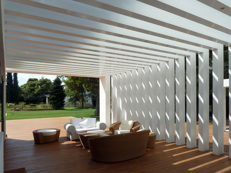 pergola with a series of dense posts & beams (originally designed in concrete but carried out in aluminium