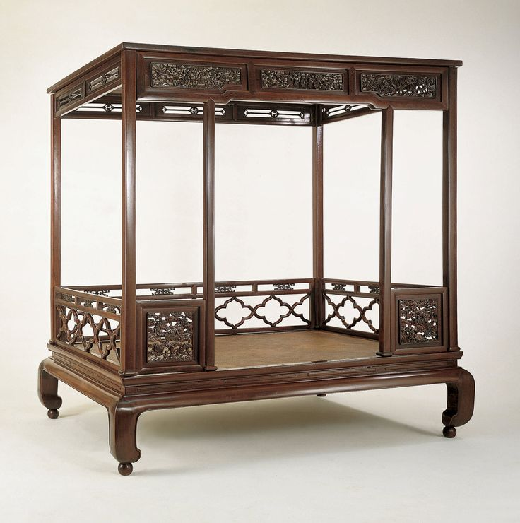 A QING DYNASTY CHI-CH' IH-MU WOOD SIX-POST CANOPY BED Overall Height: 86 in. (218.5 cm), Platform Height: 20 in. (51 cm.), Length: 87 in. (221 cm.) Depth: 65.25 in. (166 cm.), Circa 1700-1775 The sophistication of the craftsmanship, design, materials, and numerous motifs seen in this Canopy Bed is an indication that furniture of great beauty and refinement was still produced in the 18th century. It is rare to find a six-post canopy bed of chi-ch' ih-mu wood in such fine condition from this…