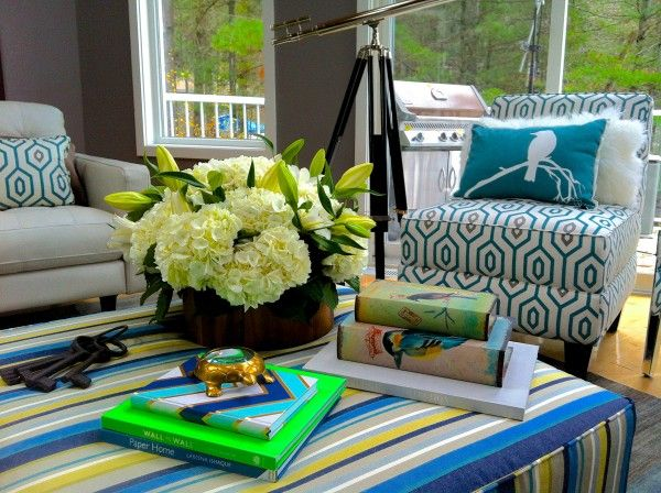 I adore the very large ottoman I custom covered in a stunning blue and green stripe fabric! It evokes a slightly more relaxed casual feel – who doesn't want plenty of room to put your feet up at the cottage!  Love Your Space with Nicholas Rosaci