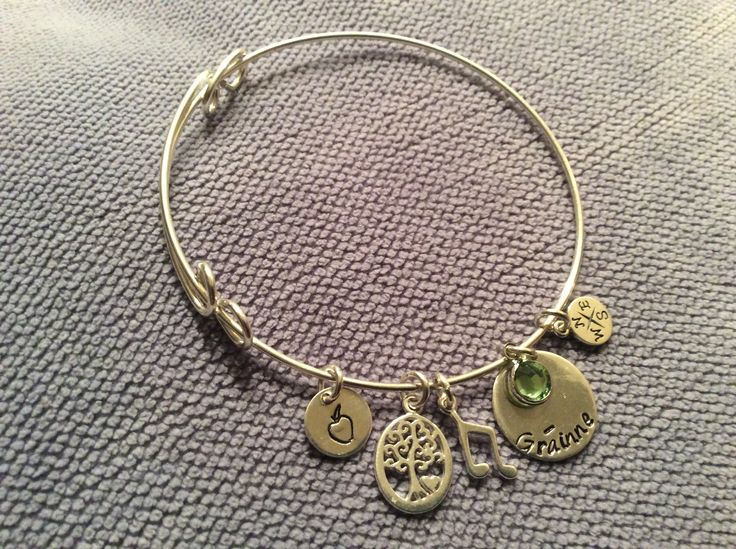Sterling silver expandable bracelet with personal charms for a teaching/music/travel loving friend and hand stamped disc with their name!